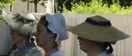 Women wearing colonial era hats