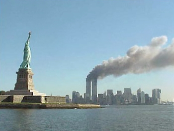 Essay On Importance Of Good Health Twin Towers On Fire With Statue Of Liberty In Foreground Examples Of Thesis Statements For Argumentative Essays also Topics For An Essay Paper Us History September  Attacks  For Kids Essay Health