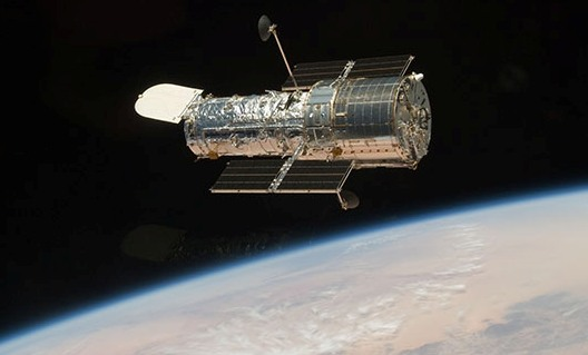 Hubble Space Telescope above the Earth